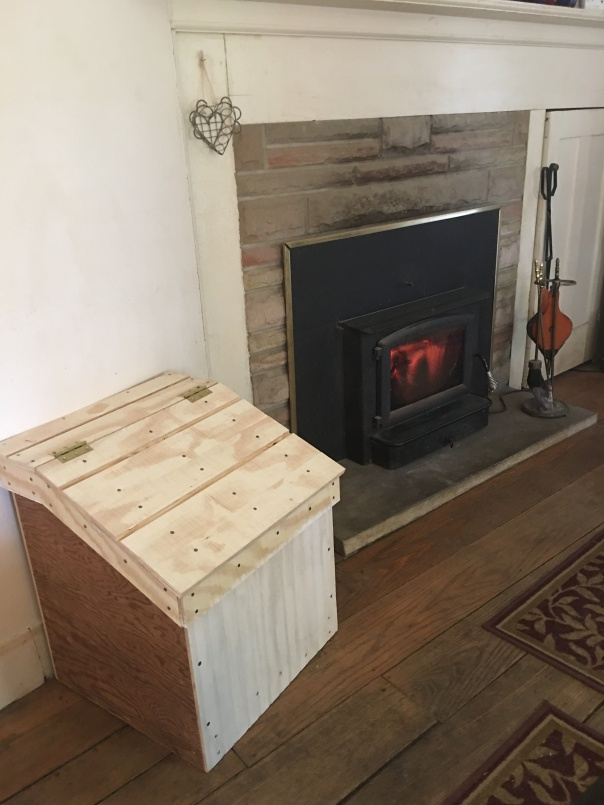 Wood box by fireplace